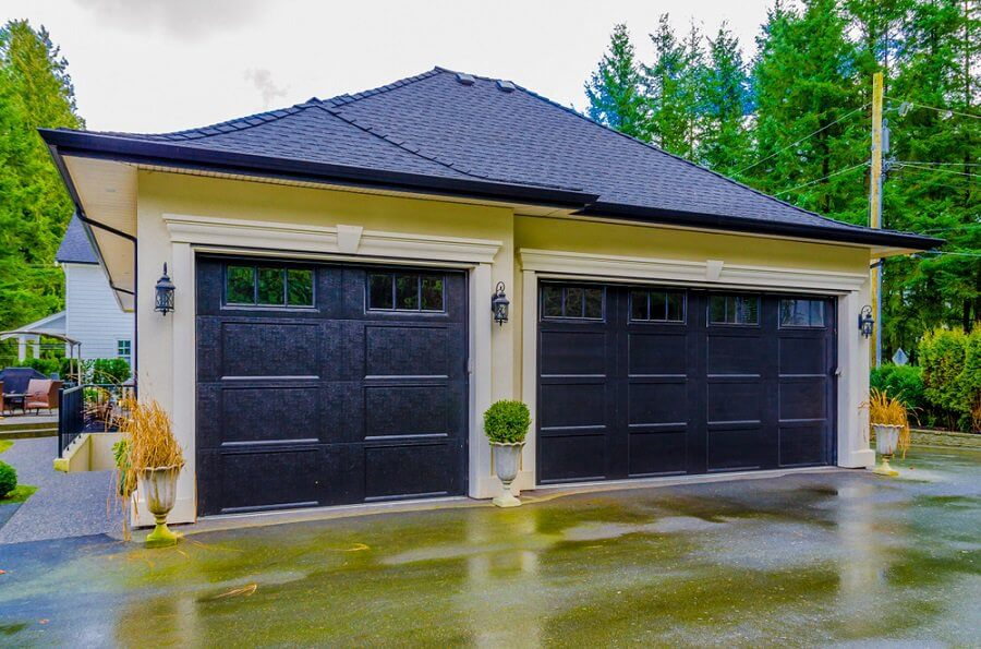 SIMPLY DIY GARAGE DOOR MAKEOVER IDEAS WITH LANTERNS AND PLANTS