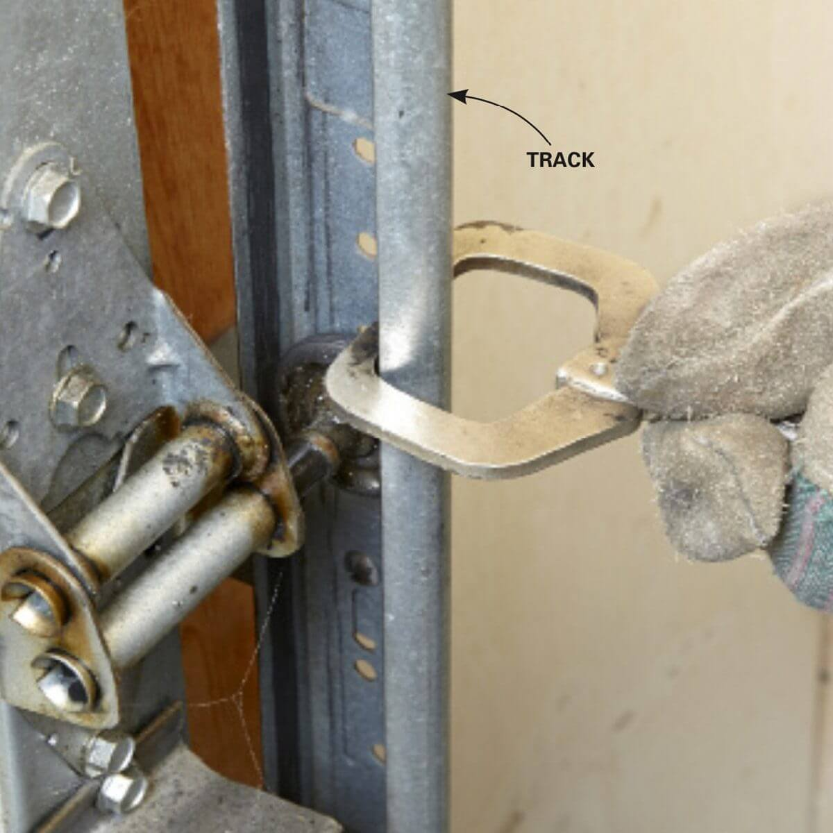 CLAMPING THE DOOR TO THE TRACK - HOW TO INSTALL SINGLE TORSION SPRING