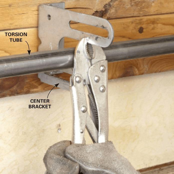 HOW TO REPLACE GARAGE DOOR SIDE SPRINGS. REMOVE THE BROKEN SPRING