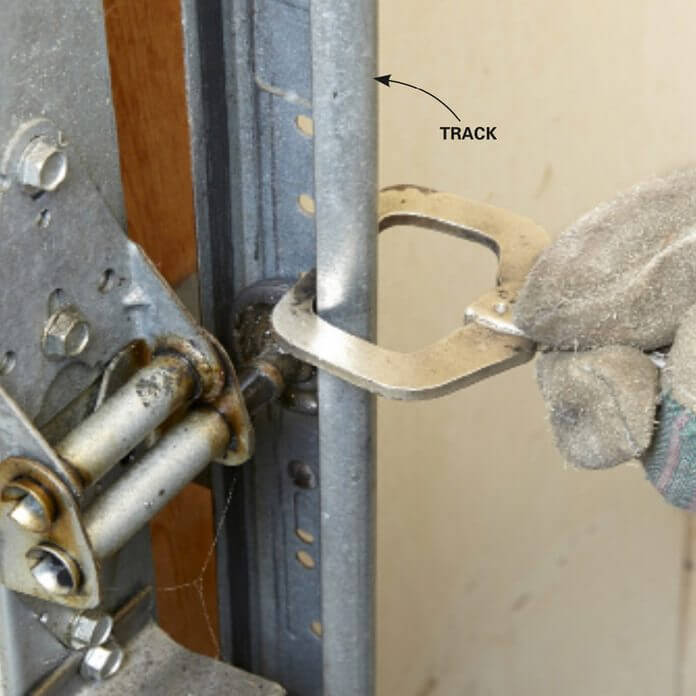HOW TO REPLACE GARAGE DOOR SIDE SPRINGS. SECURE THE DOOR AND POWER CORD