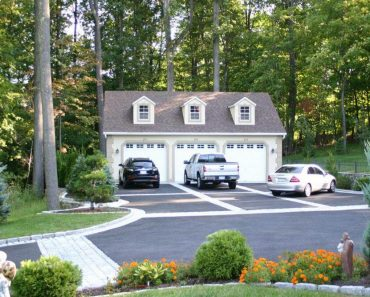 HOW BIG SHOULD THE DIMENSIONS OF A THREE-CAR GARAGE BE?