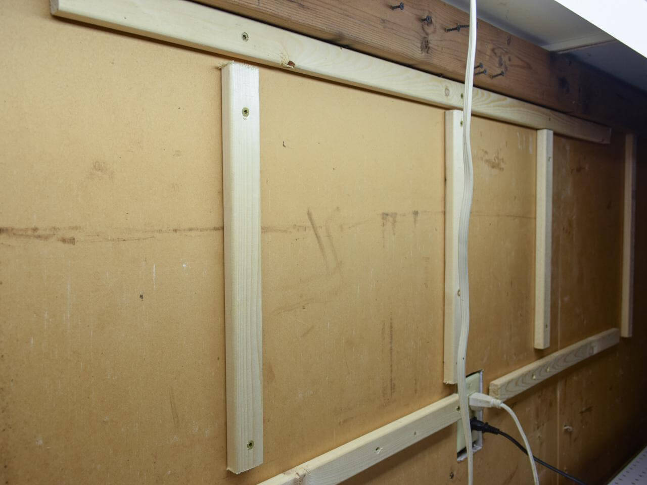 HOW TO BUILD WALL MOUNTED GARAGE SHELVES. 4. INSTALL THE SUPPORTING BOARDS