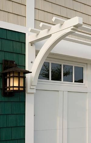 OUTSIDE GARAGE DECORATING IDEAS WITH WHITE ARBORS