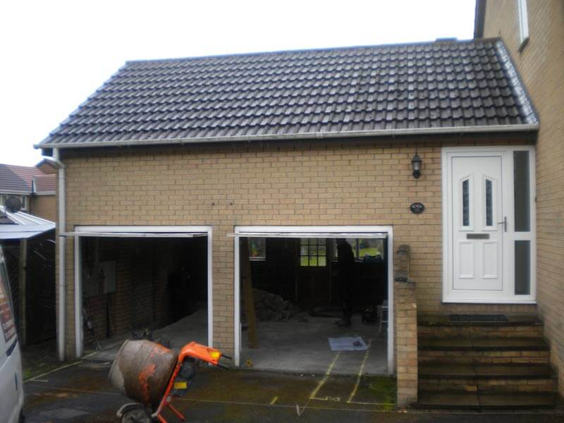 THE ESTIMATED COST TO EXTEND DOUBLE GARAGE FRONT