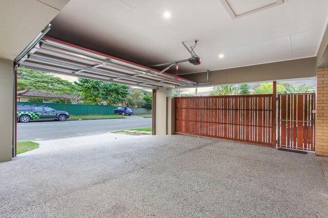 THE ESTIMATED COST TO EXTEND GARAGE